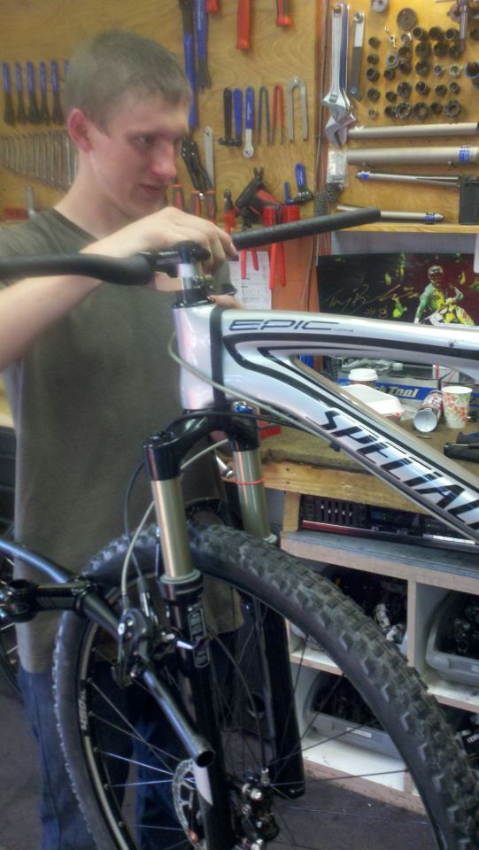 The crew at All Mountain Cyclery putting a 50 mm stem and 780 mm bars on a XC Race bike!