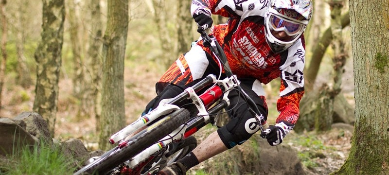 Steve Peat cornering hard and fast while clipped in!